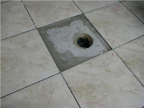 A hole in a bathroom floor