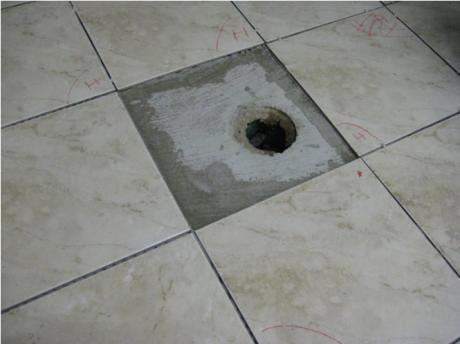 A hole in a bathroom floor